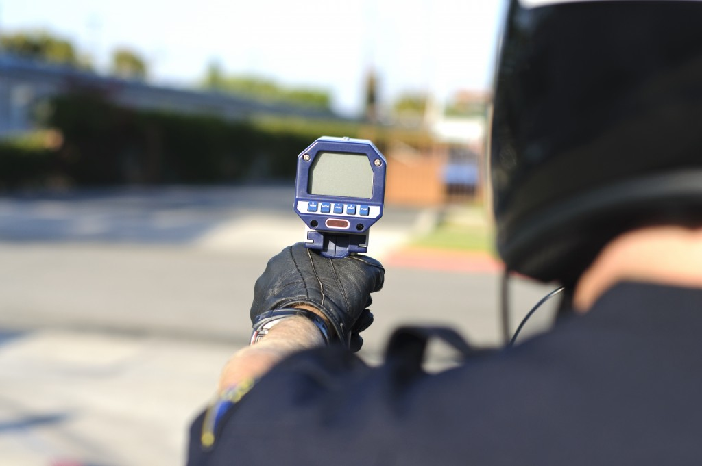 Officer holding a speed gun