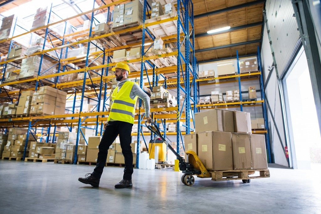 man pulling carton boxes from warehouse