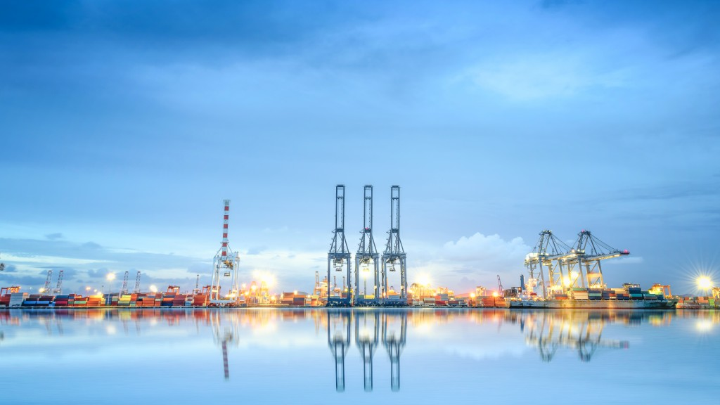 landscape photo of port, boats, cranes and shipping materials