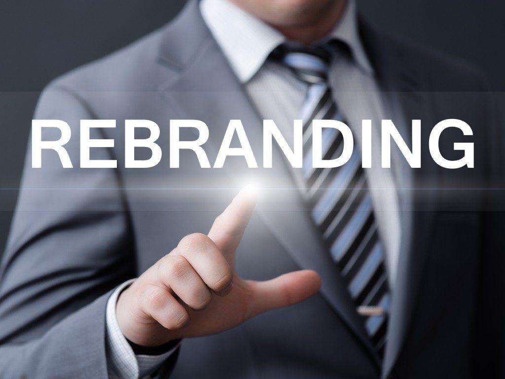 man pointing at rebranding word