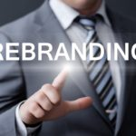 man pointing at rebranding word