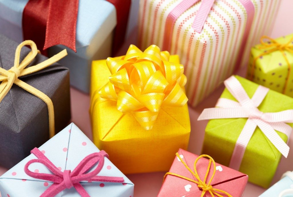 different colored gift boxes