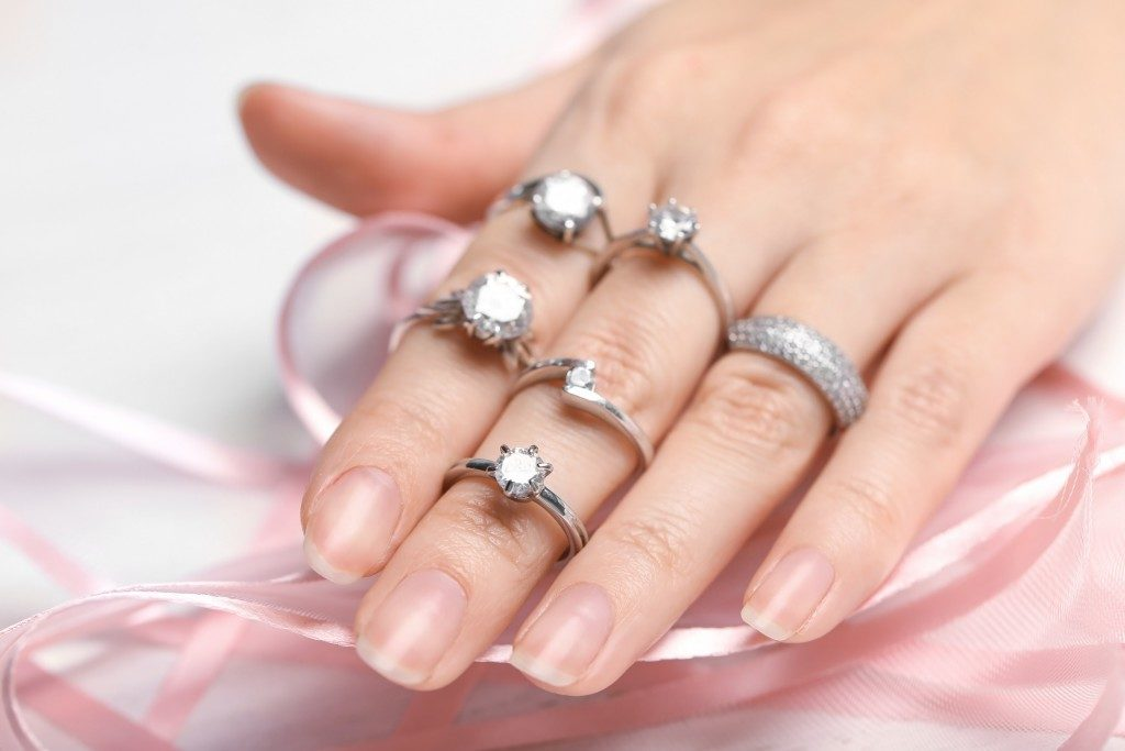 woman wearing rings