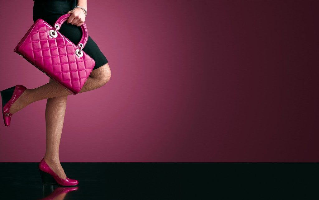woman holding a pink bag