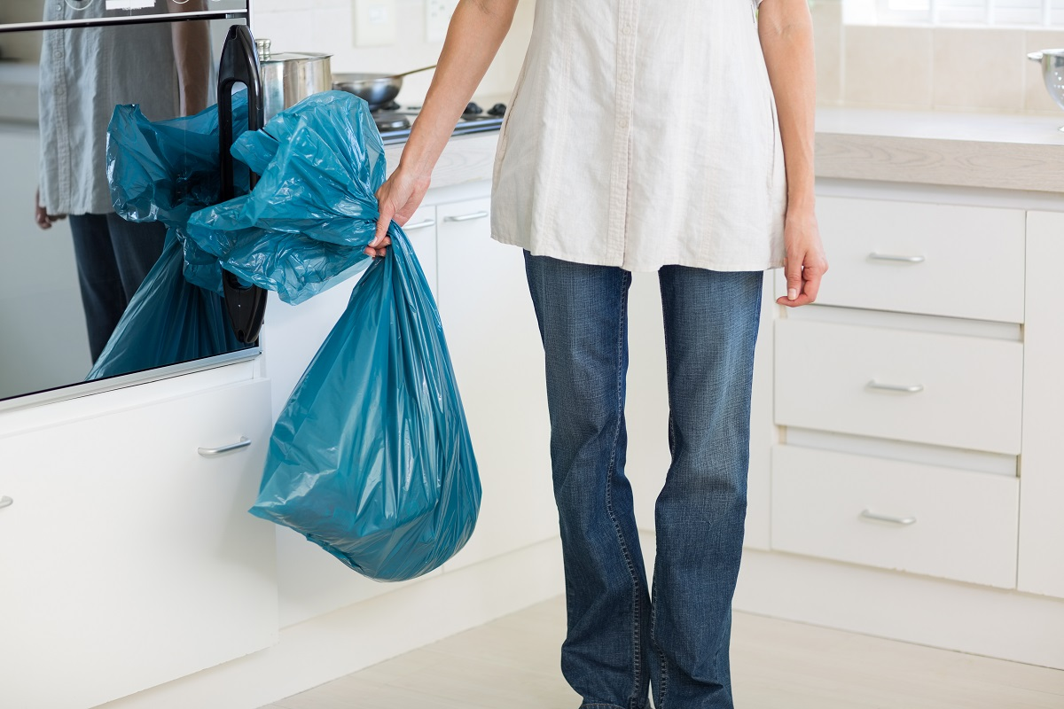 person holding a garbage bag