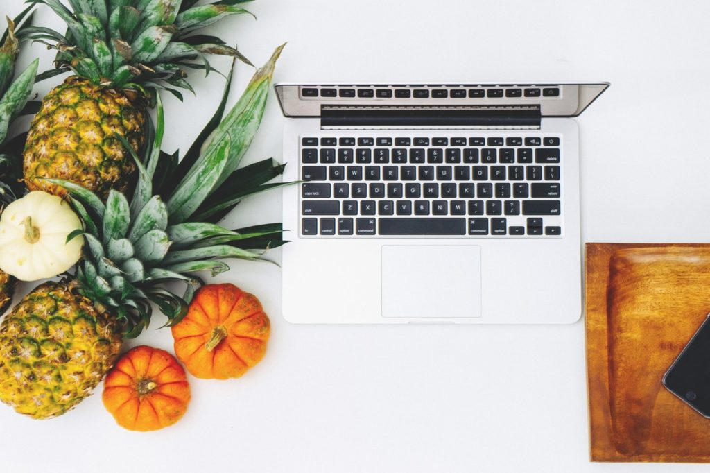 fruits near a laptop