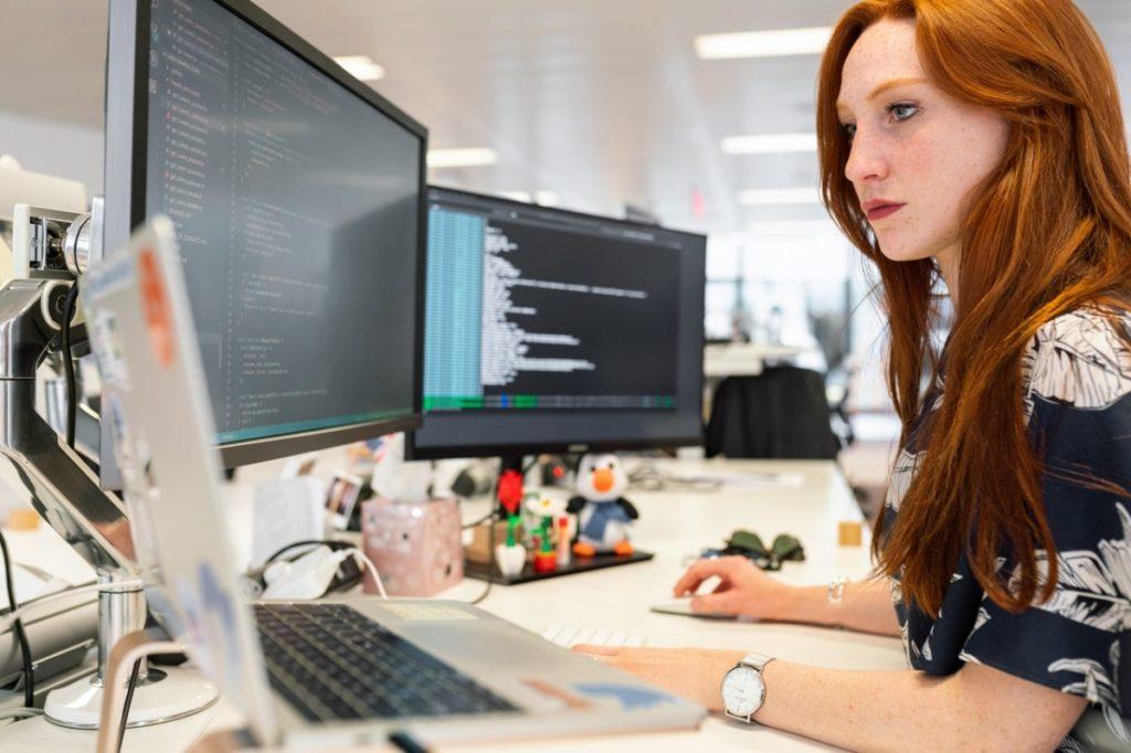woman writing codes