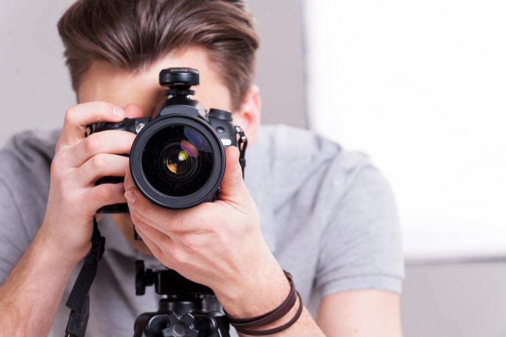 man taking a photograph