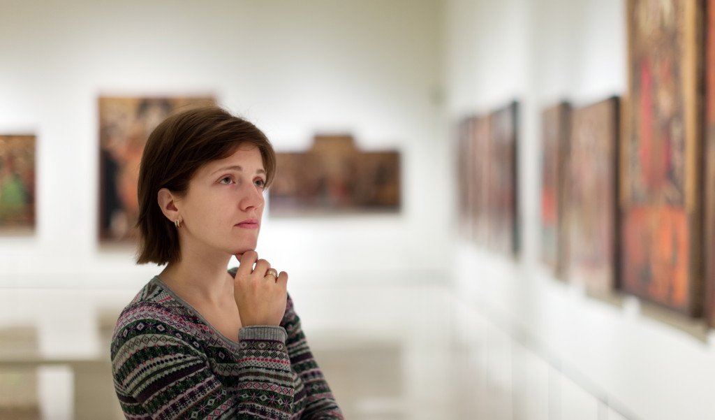 woman admiring art